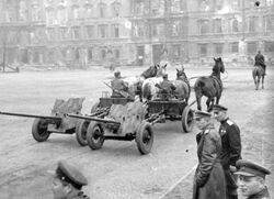 Two M-42 Anti-Tank Guns being towed through the streets by horses, Berlin 1945