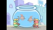 561 Men Carrying Giant Fishbowl 3