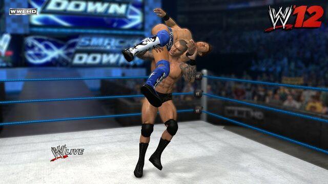 File:Randy Orton slams The Miz.jpg
