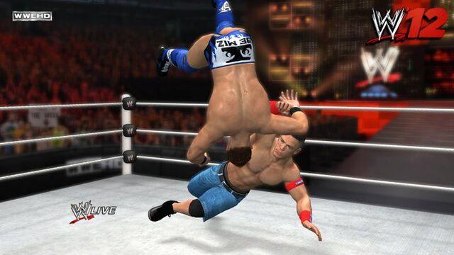 File:John Cena hip tosses The Miz.jpg