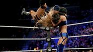 Ember uppercutting Billie Kay