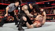 Reigns attacking Orton