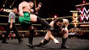Samoa Joe kicking Bull Dempsey