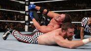 AJ-Styles putting Zayn into a submission lock