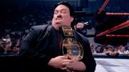 Paul-Bearer holding the WWE Champion