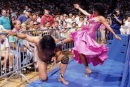 Sherri kicking Jimmy-Snuka