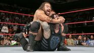 Rusev putting Reigns in submission
