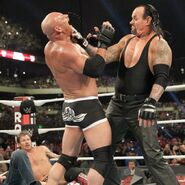 Goldberg get choke by Undertaker