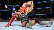 Lana grabbing on Becky-Lynch