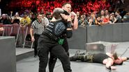 Samoa-Joe putting Roman in a sleeperhold