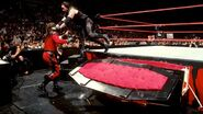 Undertaker jumping on Kane