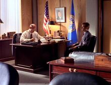 Walter Skinner sits with Fox Mulder