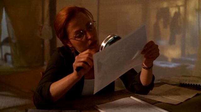 File:Dana Scully studies photograph of Ivory Coast UFO.jpg