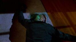 Faceless alien lies dead