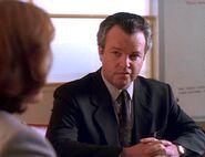 Fuller listens to Dana Scully