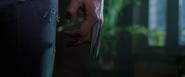 Logan retracting his claws (X2 - 2003)