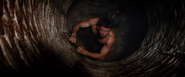Logan climbing out of the well (Nagasaki - August 1945)
