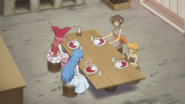 The girls sit down to eat
