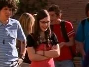 Quinn watches in amusement as Logan gets assaulted by Zoey and Lola