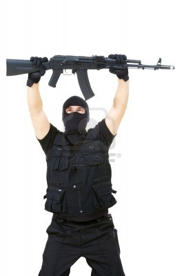 File:9360192-portrait-of-armed-assassin-raising-rifle-in-his-hands-over-white-background.jpg